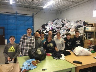 Mechanical Power Helps WINGS with Donated Clothing